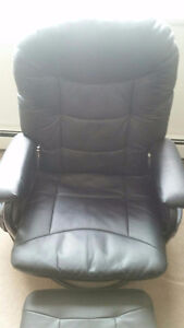 Leather recliner chair.  Two side pockets. Rocks out