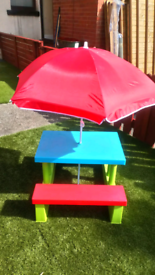 Kids plastic picnic table with parasol
