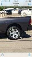 Trade dodge sport rims 1000kms for black rims and tires.