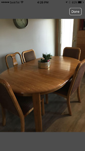 Solid oak table with leaf and 6 chairs