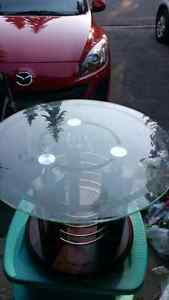 2 glass side tables and a glass coffee table