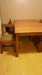 Wood dinning table with 4 chairs.