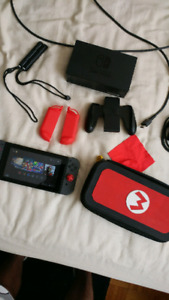 Nintendo switch console with 2 games and carrying case