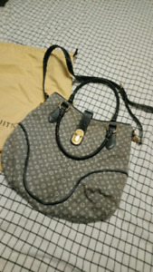 Rarely used Louis Vuitton Messenger Hand Bag