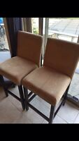 Pair of beige suede bar stools in good condition