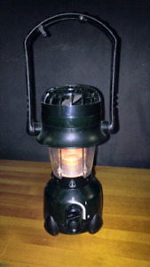 Portable lantern with built in fan