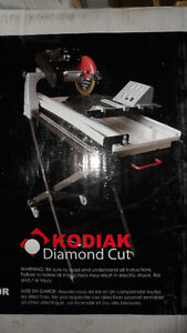 """10"""" LASER GUIDED TILE SAW WITH STAND West Island Greater Montréal image 1"""
