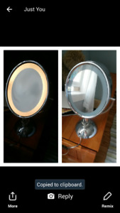 Electric lighted makeup mirror