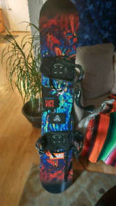Snowboard, helmet, and goggles 154cm Sims