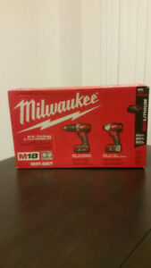 "Milwaukee M18 cordless 2 tool combo kit includes 1/2"" hammerdril"