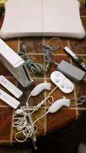 Nintendo WII + 3 Controllers + wires + FIT BOARD   **CHEAP**