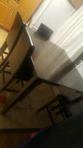 Dark wood dinning table with 4 high chairs