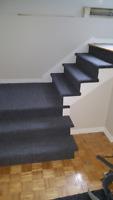 $425 Pour tapis et installation pour escalier.