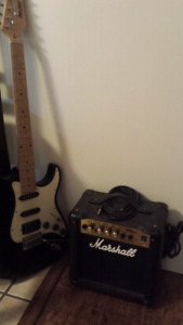 Guitar, amp, patch cord