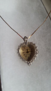 14k Gold chain with heart watch pendant has real diamonds.