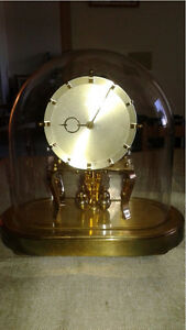 Dome Clock with spinning Pendulum