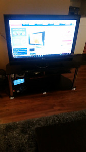 """LG 39"""" TV in Perfect working condition with TV Stand Included"""