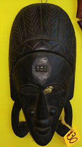Dark Wood Mask with Large Ear Lobes and Decorative Crown