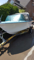 late 60's Crestliner with 40 Horse Evinrude motor and trailer