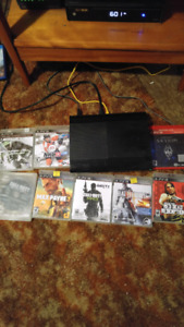 Ps3 250g slim with 8 games