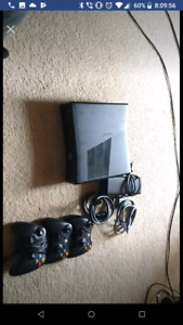 Xbox 360 with 3 controllers and 4 video games for sale  Calgary