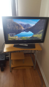 "$175, Sony TV, 35"" x 19.5"", LCD digital colour, remote, stand"