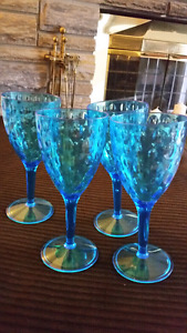 4 blue plastic wine glasses