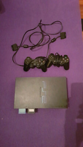 Playstation 2 w/ 2 controllers & 13 games
