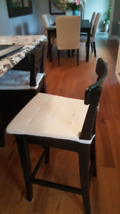 Two black IKEA Ingolf counter-height stools
