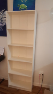 Two matching IKEA white shelves