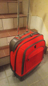 2 Red Heys Suitcases  - Carry On and Suitcase