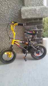 """$65 nearly new, gently used 12"""" wheel boys yellow and black bike"""