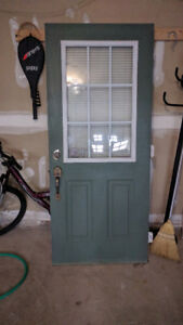 Used Entry door with full lock system and blinds