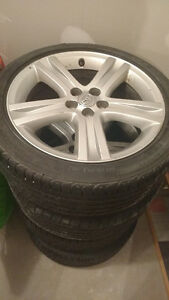"15"" Goodyear all season Eagle Sport tires with Alloy Rims"