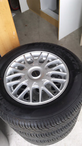 "15"" 4x100 honda/acura/toyota rims with new tires"
