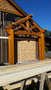 CEDAR TIMBER FRAME STRUCTURE AND GARAGE DOORS