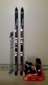 Ski with boots, poles and bag