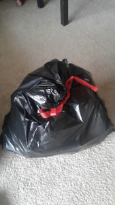 Garbage Bag Right Full Of A Variety Of VHS Movies