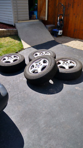 Selling 4 Michelin Defender Tires on Alloy Rims