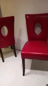 2 red leather dining chairs