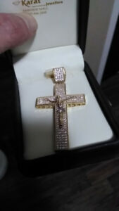 Gold cross pendant paid 1400$