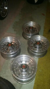 """4-15x8"""" Ford 1/2ton Factory aluminum mags"""