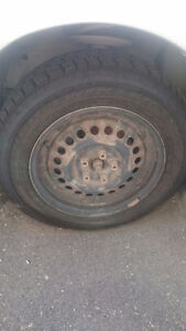 4 Goodyear Nordic winter tires on Rims Like New!