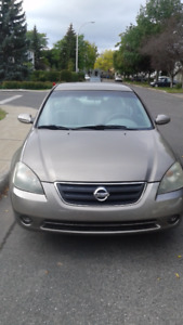 2003 Nissan Altima 2.5s with starter&4 all season tires on mags