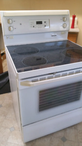 GE self cleaning oven and flat top ceramic stove.