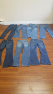 7 pairs of girls jeans size 7/8