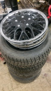 4 205/55/16 winter tires on 5 x 100 rims w/ hubcaps