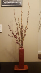 Decorative red vase with willows