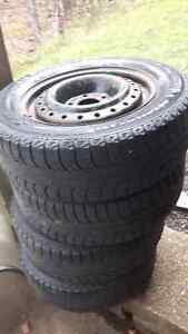 four 195/65r15 michellin winter tires on steel rims off Civic