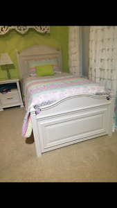 Twin size bed with trundle bed or storage drawers.
